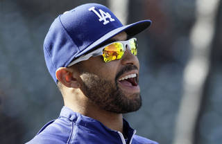 "Los Angeles Dodgers center fielder Matt Kemp smiles during warmups before the Dodgers' baseball game against the San Francisco Giants in San Francisco, Monday, June 25, 2012. The Dodgers have all but ruled out injured slugger Kemp for next month's All-Star game in Kansas City. General manager Ned Colletti calls it a ""long shot"" for Kemp to play, with the outfielder still recovering from a strained left hamstring. (AP Photo/Jeff Chiu) ORG XMIT: FXPB101"