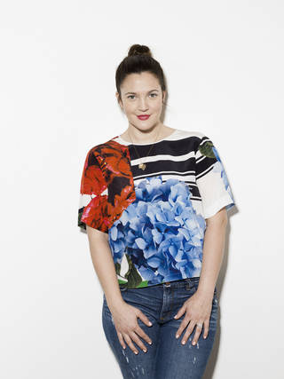 """Drew Barrymore poses for a portrait in promotion of the launch of her new cosmetics line """"Flower"""", on Monday, Jan. 14, 2013 at the Maesa offices in New York. (Photo by Victoria Will/Invision/AP Images) ORG XMIT: NYVW102 Victoria Will - Victoria Will/Invision/AP"""