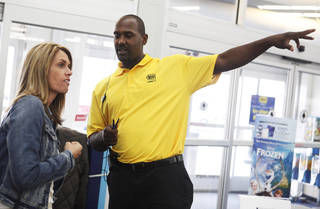 Former Oklahoma State basketball player Ivan McFarlin helps a customer at the Best Buy in Stillwater. PHOTO BY K.T. KING FOR THE OKLAHOMAN.