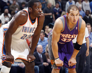 Phoenix Suns forward Taylor Griffin, right, who played at OU, returned to his hometown Monday when the Suns played against the Oklahoma City Thunder in a preseason game at the Ford Center. The Thunder won, 110-105 in overtime. PHOTO BY CHRIS LANDSBERGER, THE OKLAHOMAN