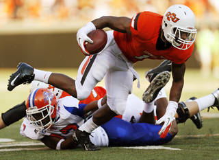 OSU's Joseph Randle (1) carries the ball in the first quarter during a college football game between Oklahoma State University (OSU) and Savannah State University at Boone Pickens Stadium in Stillwater, Okla., Saturday, Sept. 1, 2012. Photo by Nate Billings, The Oklahoman