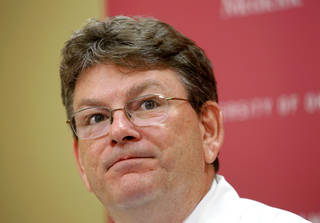 Dr. James Lane, an endocrinologist, shown here, and his patient Nathan Mobley, 35, talked about a lesser known type of diabetes called Latent Autoimmune Diabetes in Adults (LADA) at a press conference Tuesday, July 30, 2013, at the Harold Hamm Diabetes Center at the University of Oklahoma in Oklahoma City. M obey was recently diagnosed with the disease. Photo by Jim Beckel, The Oklahoman.