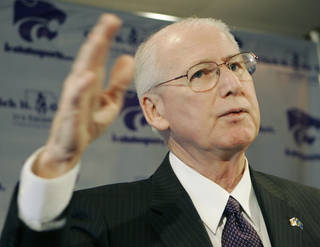 Bill Snyder, shown here at a news conference announcing his return as Kansas State's football coach, was back at the Big 12 football media days Wednesday. (AP Photo/Orlin Wagner)