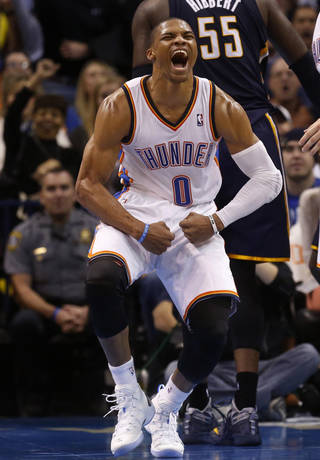 Oklahoma City Thunder guard Russell Westbrook (0) celebrates during the third quarter of an NBA basketball game against the Indiana Pacers in Oklahoma City, Sunday, Dec. 8, 2013. Oklahoma City won 118-94. (AP Photo/Sue Ogrocki)