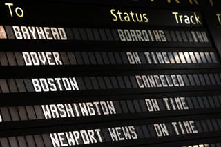The Amtrak departures board on Friday shows a canceled train to Boston at Penn Station in New York. Mass transit to and from the Boston area was virtually shut down Friday as police conducted a massive manhunt for a suspect in Monday's Boston Marathon bombing. AP Photo