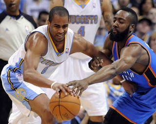 Denver Nuggets guard Arron Afflalo (6) and Oklahoma City Thunder guard James Harden (13) go after a loose ball during the first half of game 3 of a first-round NBA basketball playoff series Saturday, April 23, 2011, in Denver. (AP Photo/Jack Dempsey)