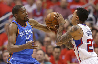 Oklahoma City's Kevin Durant (35) fouls Los Angeles' Matt Barnes (22) during Game 6 of the Western Conference semifinals in the NBA playoffs between the Oklahoma City Thunder and the Los Angeles Clippers at the Staples Center in Los Angeles, Thursday, May 15, 2014. Photo by Nate Billings, The Oklahoman