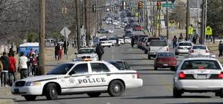Traffic is snarled as Tulsa police try to clear the Greenwood and Pine intersection of cars and pedestrians after a fight broke out at the end of the MLK parade in Tulsa, OK Jan. 18, 2009. MICHAEL WYKE/ Tulsa World