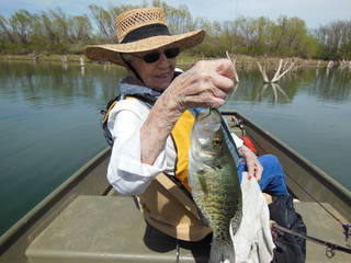 Etta Henderson, 90, of Oklahoma City enjoyed a day of crappie fishing last week as a Mother's Day present. Photo by Hal McKnight