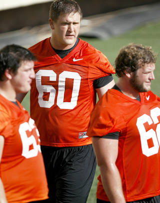 OSU offensive lineman Brady Bond, center, played 8-man football in high school at Garber. (Photo by Bryan Terry, The Oklahoman)