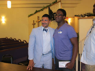 """Steve Perry, Ph.D., poses for a picture with a young attendee at """"A Heart for the Fatherless"""" conference on Aug. 10 at Fairview Baptist Church, 1700 NE 7. Perry, founder and principal of Capital Preparatory Magnet School in Washington, D.C., was the event's keynote speaker. Carla Hinton - The Oklahhoman"""