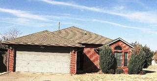 Fannie Mae has possession of this foreclosed home at 1613 Victoria Drive in Edmond, which is listed with Century 21 All Pro. Photo provided