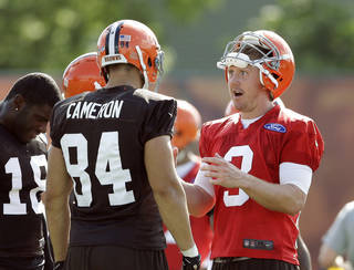 Cleveland Browns quarterback Brandon Weeden (3) talks to tight end Jordan Cameron (84) during training camp practice at the NFL football team's facility in Berea, Ohio, Friday, July 26, 2013. (AP Photo/Mark Duncan) Mark Duncan