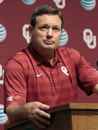 Head coach Bob Stoops speaks with reporters during the University of Oklahoma (OU) football team's media day in the Adrian Peterson Team Meeting Room on Saturday, Aug. 2, 2014 in Norman, Okla. Photo by Steve Sisney, The Oklahoman
