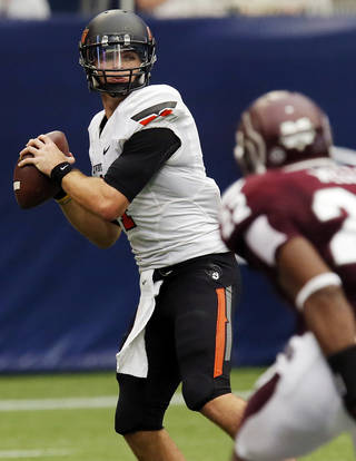Oklahoma State's J.W. Walsh (4) looks to pass during the AdvoCare Texas Kickoff college football game between the Oklahoma State University Cowboys (OSU) and the Mississippi State University Bulldogs (MSU) at Reliant Stadium in Houston, Saturday, Aug. 31, 2013. OSU won, 21-3. Photo by Nate Billings, The Oklahoman