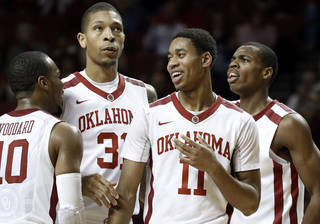Oklahoma Sooner's Jordan Woodard (10), D.J. Bennett (31), Isaiah Cousins (11) and Buddy Hield (24) react to play as the University of Oklahoma Sooners (OU) men defeat the Iowa State Cyclones (ISU) 87-82 in NCAA, college basketball at The Lloyd Noble Center on Saturday, Jan. 11, 2014 in Norman, Okla. Photo by Steve Sisney, The Oklahoman