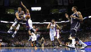 Oklahoma City Thunder's Russell Westbrook (0) passes around Phoenix Suns' Sebastian Telfair (31) as the Oklahoma City Thunder play the Phoenix Suns in NBA basketball at the Chesapeake Energy Arena in Oklahoma City, on Monday, Dec. 31, 2012. Photo by Steve Sisney, The Oklahoman