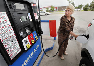 LaDonna Hardesty puts gas in her car as the price of gasoline approaches $4 per gallon on Wednesday, May 15, 2013 in Norman, Okla. Photo by Steve Sisney, The Oklahoman
