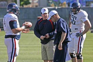 University of Arizona offensive line coach Bill Bedenebaugh, second from left, goes through practice on Wednesday, March 28, 2007, in Tucson, Ariz. Photo by A. E. Araiza/Arizona Daily Star