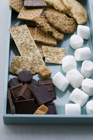 Ingredients for making toasted mocha s'mores, salted oatmeal s'mores, sesame caramel s'mores, and double chocolate grasshopper s'mores are gathered on a tray. AP Photo Matthew Mead - AP