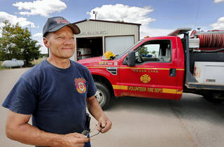 Randy Gipson is shown Tuesday at the Cedar Lake Volunteer Fire Department, east of Hinton in Canadian County. As a result of a clerical oversight, the land on which the fire department's station is located was included in a county land auction. Photo by Jim Beckel, The Oklahoman Jim Beckel - THE OKLAHOMAN