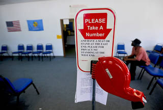 A customer waits in line at the Yukon driver's license testing office on Thursday. Photo by Chris Landsberger, The Oklahoman CHRIS LANDSBERGER - CHRIS LANDSBERGER