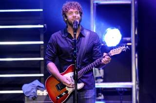 Billy Currington performs before Carrie Underwood takes to the stage at Bridgestone Arena in Nashville,Tenn. Wednesday, Oct. 13, 2010. Photo via Sanford Myers/The Tennessean