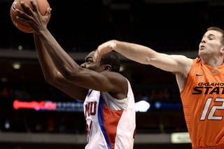 SMU guard Jalen Jones (21) shoots in front of Oklahoma State guard Keiton Page (12) in the second half of an NCAA college basketball game in Dallas, Wednesday, Dec. 28, 2011. Oklahoma St won 68-58. Oklahoma St won 68-58 in double overtime. (AP Photo/Matt Strasen) ORG XMIT: TXMS11