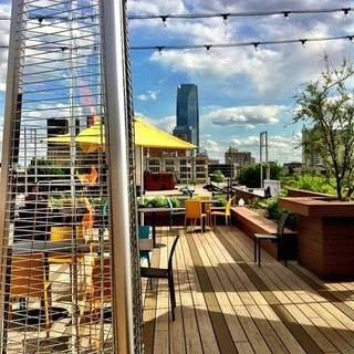 "The new ""green"" rooftop at the Packard Building features an expansive view of the downtown skyline. Provided by Packard's American Grill"