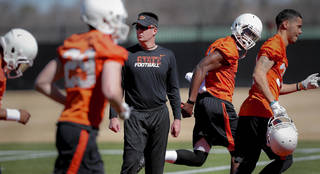 Oklahoma State head football coach Mike Gundy looks on as his team takes to the field during the first day of spring football practice at Oklahoma State University in Stillwater, Okla., on Monday, March 10, 2014. Photo by Chris Landsberger, The Oklahoman