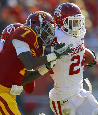 Oklahoma's Brennan Clay (24) fights off Iowa State's Cliff Stokes (7) during a college football game between the University of Oklahoma (OU) and Iowa State University (ISU) at Jack Trice Stadium in Ames, Iowa, Saturday, Nov. 3, 2012. Oklahoma won 35-20. Photo by Bryan Terry, The Oklahoman