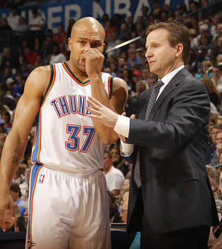 Coach Scott Brooks talks with Derek Fisher (37) during the NBA basketball game between the Oklahoma City Thunder and the Los Angeles Clippers at Chesapeake Energy Arena on Wednesday, March 21, 2012 in Oklahoma City, Okla. Photo by Chris Landsberger, The Oklahoman