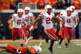 Nebraska's Niles Paul slips past OSU's Quinn Sharp as he returns a kickoff for touchdown during the college football game between the Oklahoma State Cowboys (OSU) and the Nebraska Huskers (NU) at Boone Pickens Stadium in Stillwater, Okla., Saturday, Oct. 23, 2010. Photo by Sarah Phipps, The Oklahoman