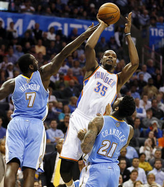 Oklahoma City's Kevin Durant shoots against Denver's J.J. Hickson and Wilson Chandler during Monday night's game at Chesapeake Energy Arena. Photo by Nate Billings, The Oklahoman
