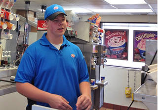 In this screen grab provided by WCCO TV is Dairy Queen employee Joey Prusak in Hopkins, Minn. Prusak is winning praise for his treatment of a visually impaired customer who unwittingly dropped a $20 bill on the floor. After another customer pocketed the bill, Prusak asked her to return it, and when she didn't, told her to leave the store. He then gave the visually impaired customer $20 from his own wallet. (AP Photo/Courtesy WCCO TV)