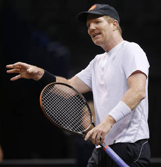 Jim Courier talks during a Champions Cup tennis match against Michael Chang at Chesapeake Energy Arena in Oklahoma City, Thursday, Feb. 6, 2014. Photo by Bryan Terry, The Oklahoman