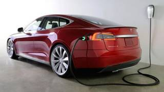 The Tesla Model S plugged into a charging station similar to the one that has been installed at the Skirvin Hilton in downtown Oklahoma City. Photo provided