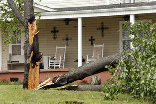 Wind damage from the previous night's severe thunderstorms is evident on Thursday in Purcell. (Photo by Steve Sisney, The Oklahoman)
