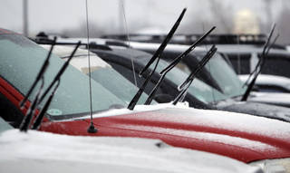 Wipers are left up and away from windshields in a parking lot near Britton Rd. and May Ave. during a winter storm in Oklahoma City, Thursday, January 28, 2010. Photo by Nate Billings, The Oklahoman
