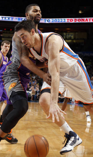 Oklahoma City's' Nick Collison (4) tries to get around Phoenix 's Markieff Morris (11) during the NBA game between the Oklahoma City Thunder and the Phoenix Suns at theChesapeake Energy Arena, Friday, Feb. 8, 2013.Photo by Sarah Phipps, The Oklahoman