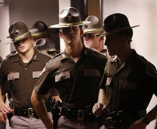 The Oklahoma Highway Patrol commissioned 40 new Troopers during a ceremony Thursday afternoon. Members of the graduating class wait in a hallway to march into the program. Photo by Jim Beckel, The Oklahoman. Jim Beckel