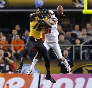 Oklahoma State's Tyler Patmon (26) deflects the ball away from Missouri's Dorial Green-Beckham (15) during the AT&T Cotton Bowl Classic college football game between the Oklahoma State University Cowboys (OSU) and the University of Missouri Tigers at AT&T Stadium in Arlington, Texas, Friday, Jan. 3, 2014. Oklahoma State lost 41-31. Photo by Bryan Terry, The Oklahoman