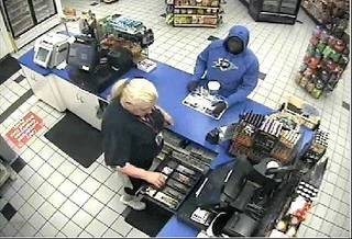 On 7/4/12 at approximately 1:55 a.m., police responded to an armed robbery at the Circle K store at 4501 NW 39th. The suspect walked up to the counter after picking up a 32 ounce drink, produced a pistol and demanded cash. After taking money from the till, the suspect walked away from the store. There was no vehicle involved and nobody was injured. Surveillance cameras captured images of the suspect (see attached photos). The suspect was described as a black male wearing a blue Thunder hooded sweatshirt. Anyone with information should contact Crime Stoppers at 405/235-7300. Callers to Crime Stoppers can remain anonymous and may be eligible for a cash reward.