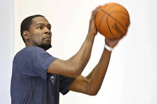 Oklahoma City Thunder forward Kevin Durant (35) shoots extra baskets following a team practice in Oklahoma City, Monday, April 28, 2014. The Thunder face the Memphis Grizzlies in Game 5 of the first round of the NBA basketball playoffs on Tuesday. (AP Photo)