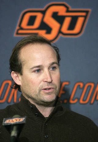 FILE - In this Feb. 3, 2010, file photo, Oklahoma State offensive coordinator Dana Holgorsen addresses the media during a news conference in Stillwater, Okla. Holgorsen has been hired for the same position at West Virginia next season, and the Mountaineers plan to make him head coach in 2012. (AP Photo/Sue Ogrocki, File)