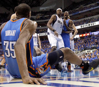 Oklahoma City's Serge Ibaka (9) reacts beside Brendan Haywood (33) of Dallas after a Kevin Durant dunk during game 2 of the Western Conference Finals in the NBA basketball playoffs between the Dallas Mavericks and the Oklahoma City Thunder at American Airlines Center in Dallas, Thursday, May 19, 2011. Photo by Bryan Terry, The Oklahoman