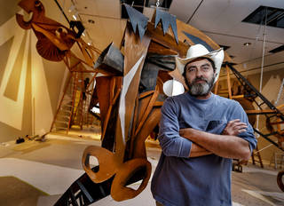 Artist Wayne White poses for a photo with his artwork that is being installed at the OKC Museum of Art on Thursday, May 9, 2013, in Oklahoma City, Okla. The exhibit will open Thursday, June 6, 2013. Photo by Chris Landsberger, The Oklahoman ORG XMIT: KOD CHRIS LANDSBERGER - CHRIS LANDSBERGER