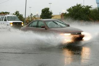 Cars plow through deep water after a downpour at 33rd and Broadway in Edmond, OK, Thursday, Aug. 11, 2011. By Paul Hellstern, The Oklahoman ORG XMIT: KOD