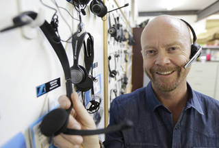 CEO and President Mike Faith of Headsets.com stands by a display of headsets earlier this month in his San Francisco offices. Headsets.com might have to hire two staffers to handle the administrative work if sales tax collection laws are changed, Faith said. The company has operations in California and Tennessee and sells to all 50 states. Currently, federal law only requires the company to collect sales tax in those two states. AP Photo