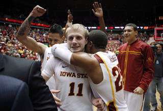 Iowa State guard Scott Christopherson (11) gets a hug from teammate Tyrus McGee after his shot at the buzzer gave Iowa State a 71-68 victory over Oklahoma State in an NCAA college basketball game, Wednesday, Jan. 18, 2012, in Ames, Iowa. (AP Photo/Charlie Neibergall) ORG XMIT: IACN112